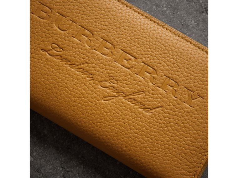 Embossed Leather Ziparound Wallet in Ochre Yellow - Women | Burberry - cell image 1