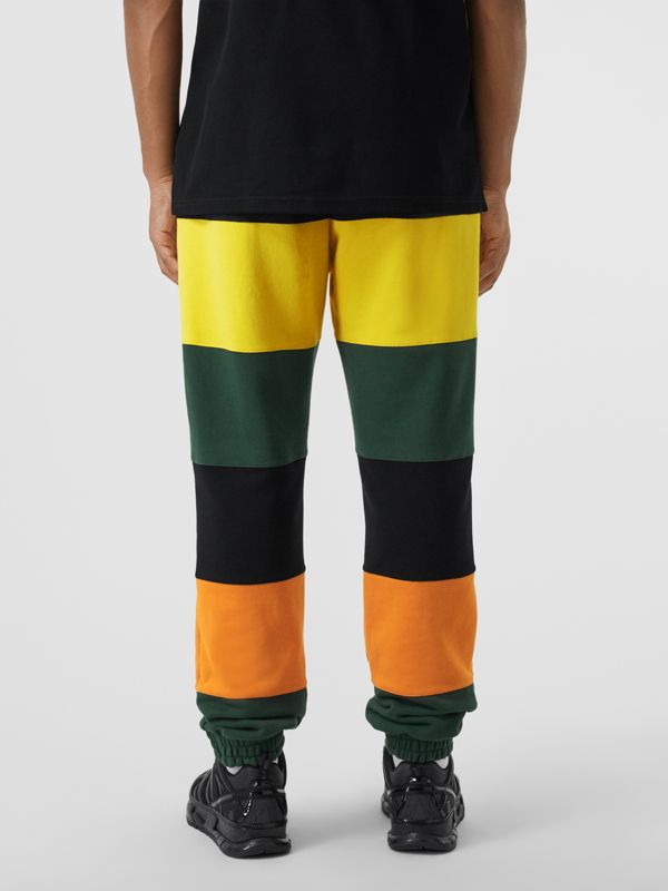 Logo Graphic Colour Block Cotton Trackpants in Canary Yellow - Men | Burberry Hong Kong S.A.R - cell image 2