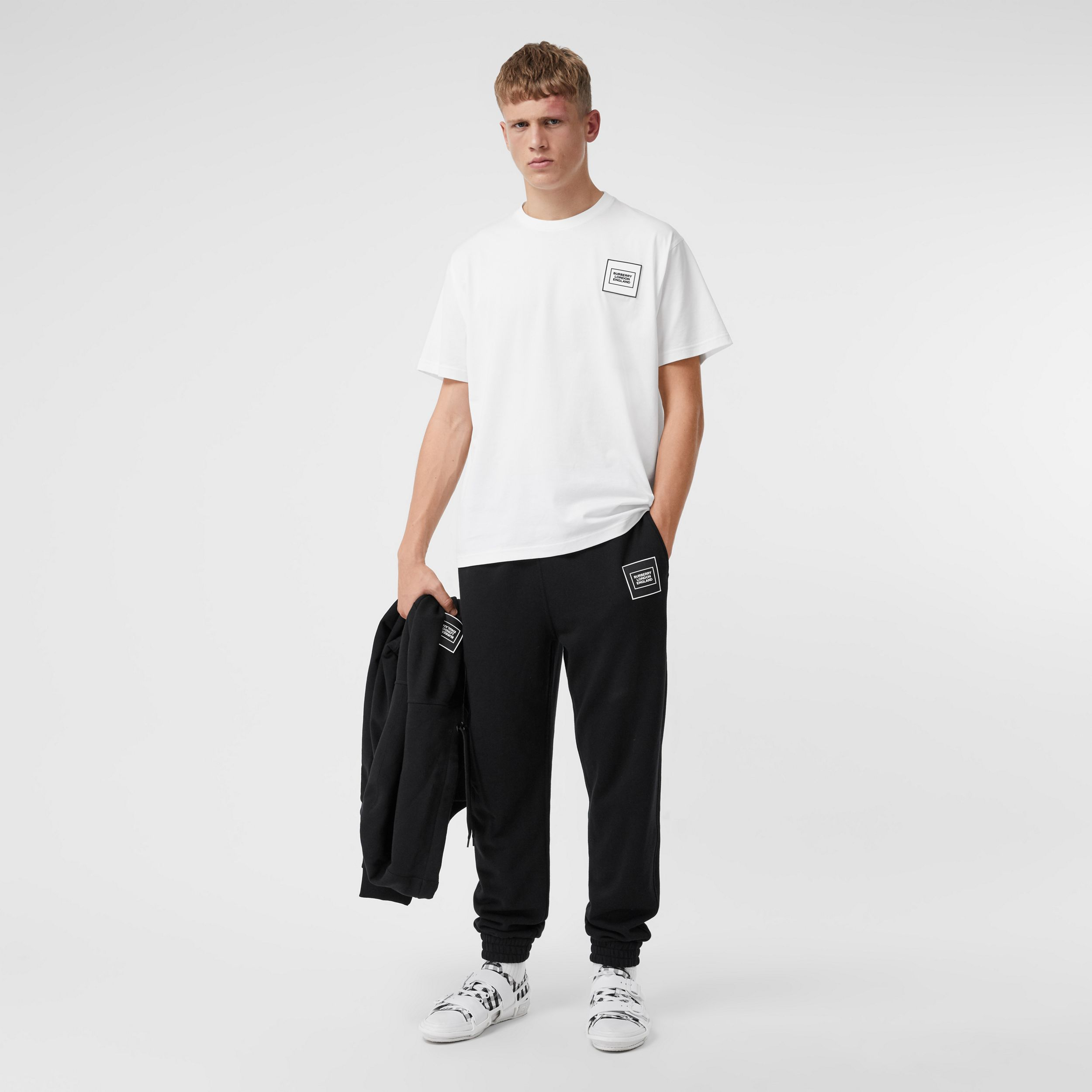 Logo Appliqué Cotton Jogging Pants in Black - Men | Burberry - 1