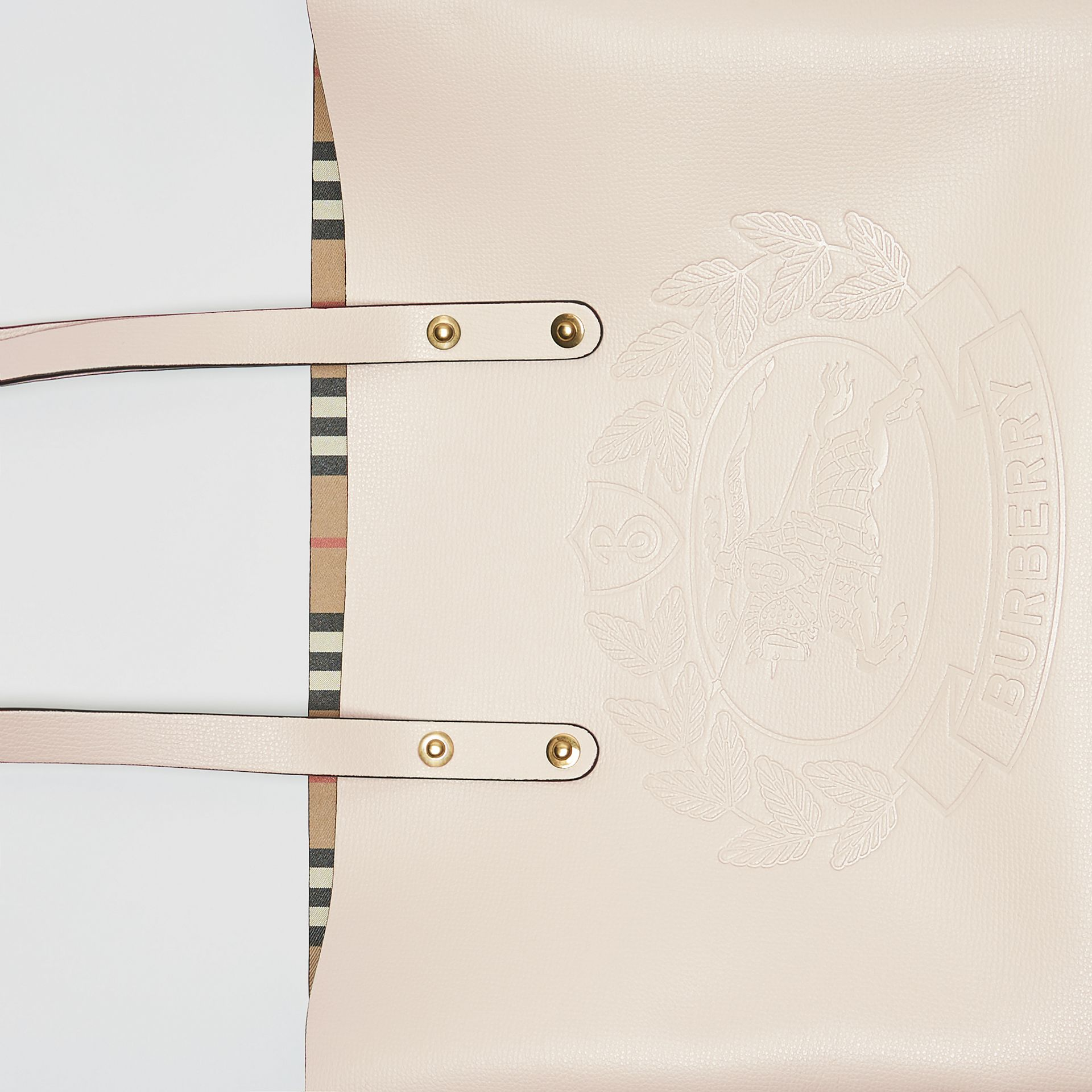 Small Embossed Crest Leather Tote in Limestone | Burberry - gallery image 1