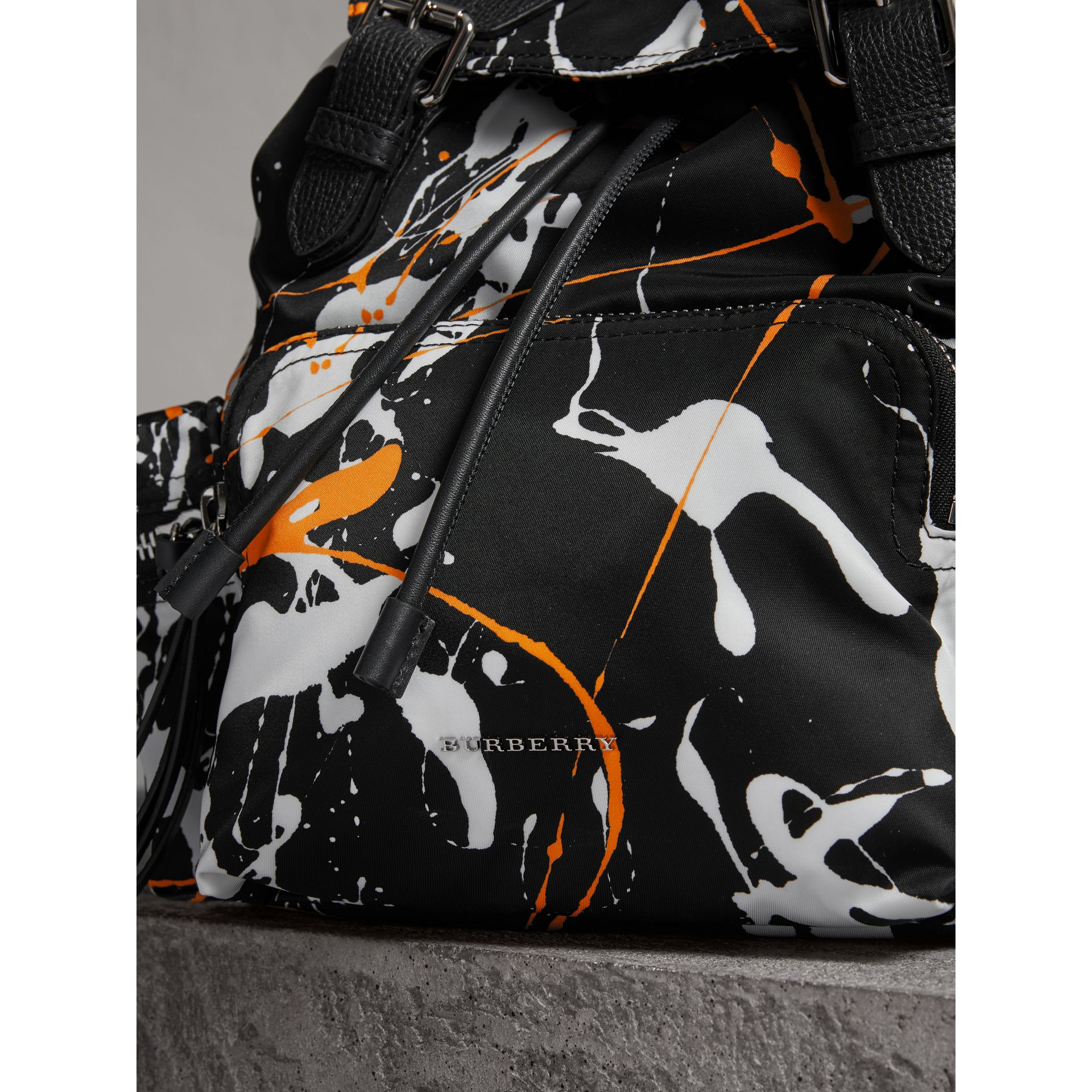 The Medium Rucksack in Splash Print in Black - Women | Burberry United Kingdom - gallery image 1