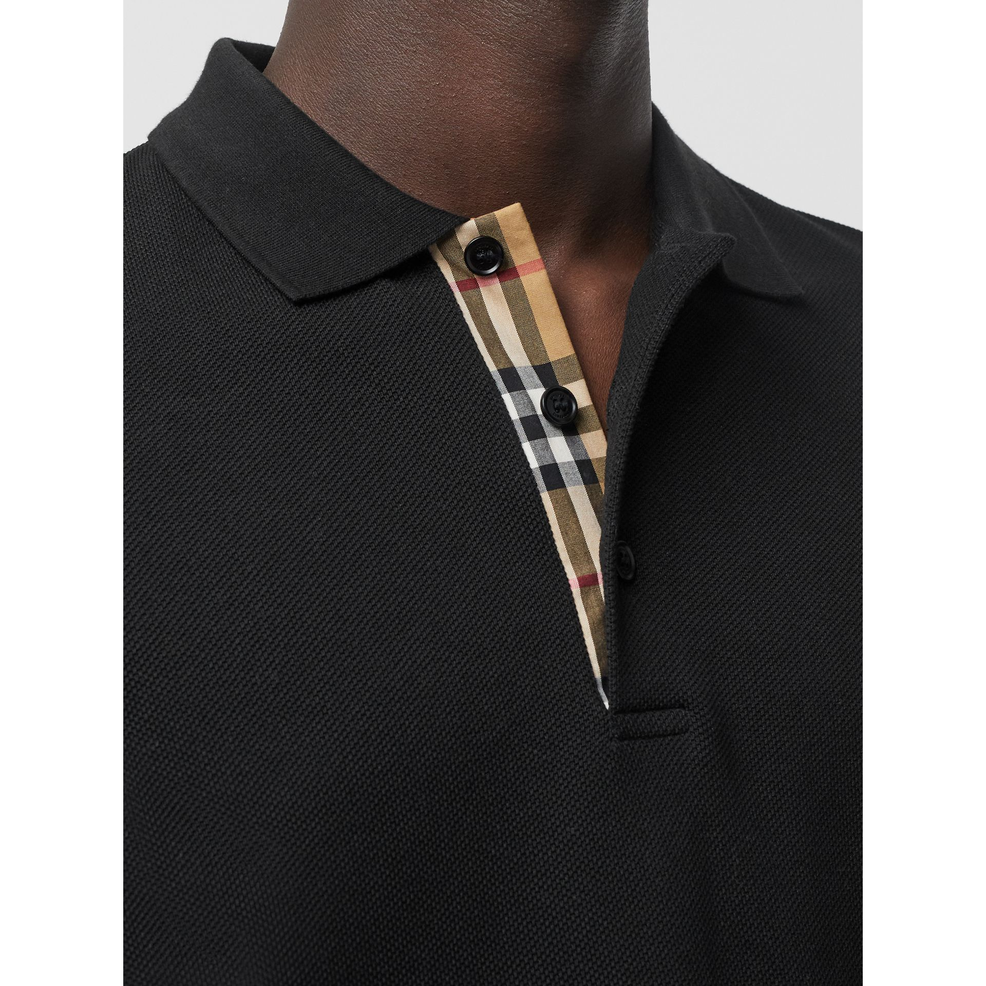Check Placket Cotton Polo Shirt in Black - Men | Burberry Singapore - gallery image 1