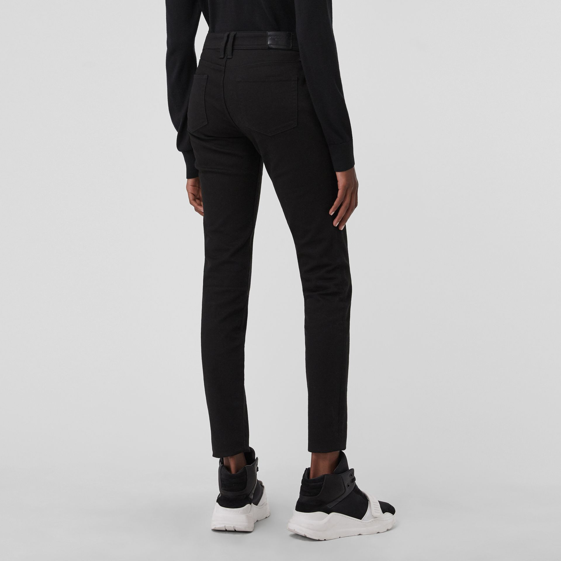 Skinny Fit Low-Rise Deep Black Jeans - Women | Burberry United States - gallery image 2