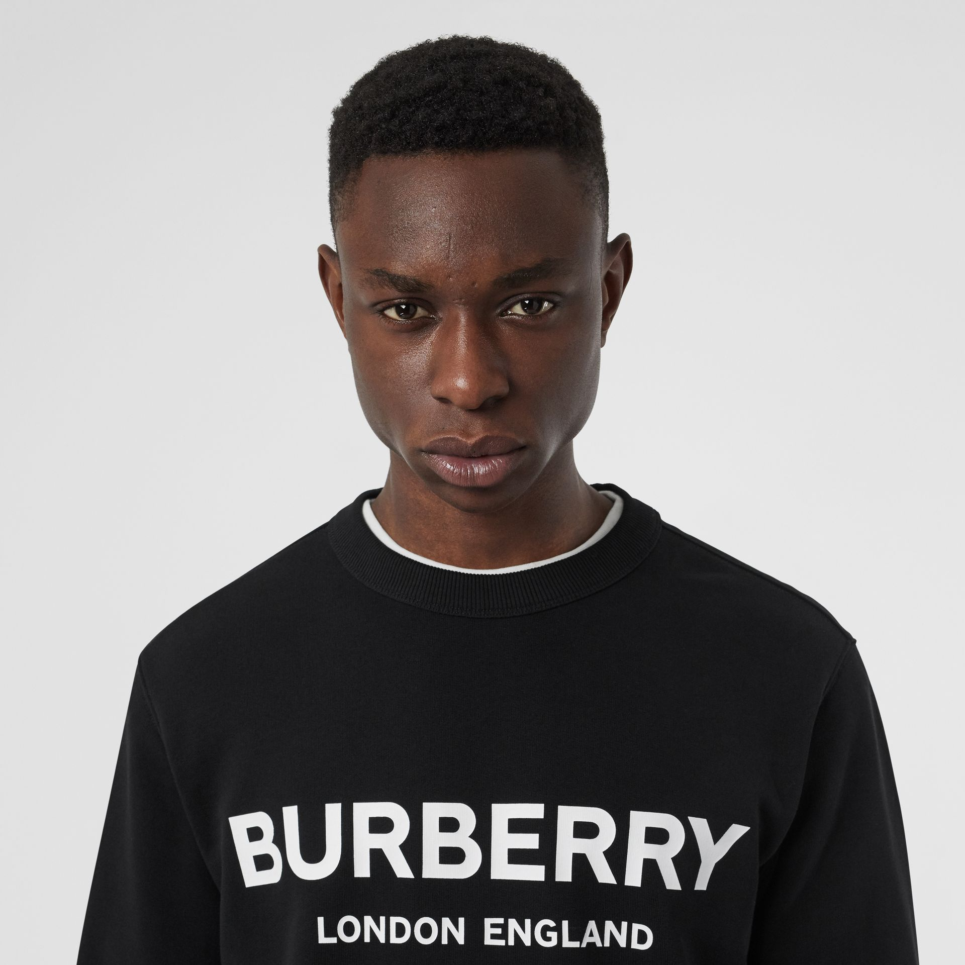 Logo Print Cotton Sweatshirt in Black - Men | Burberry - gallery image 1