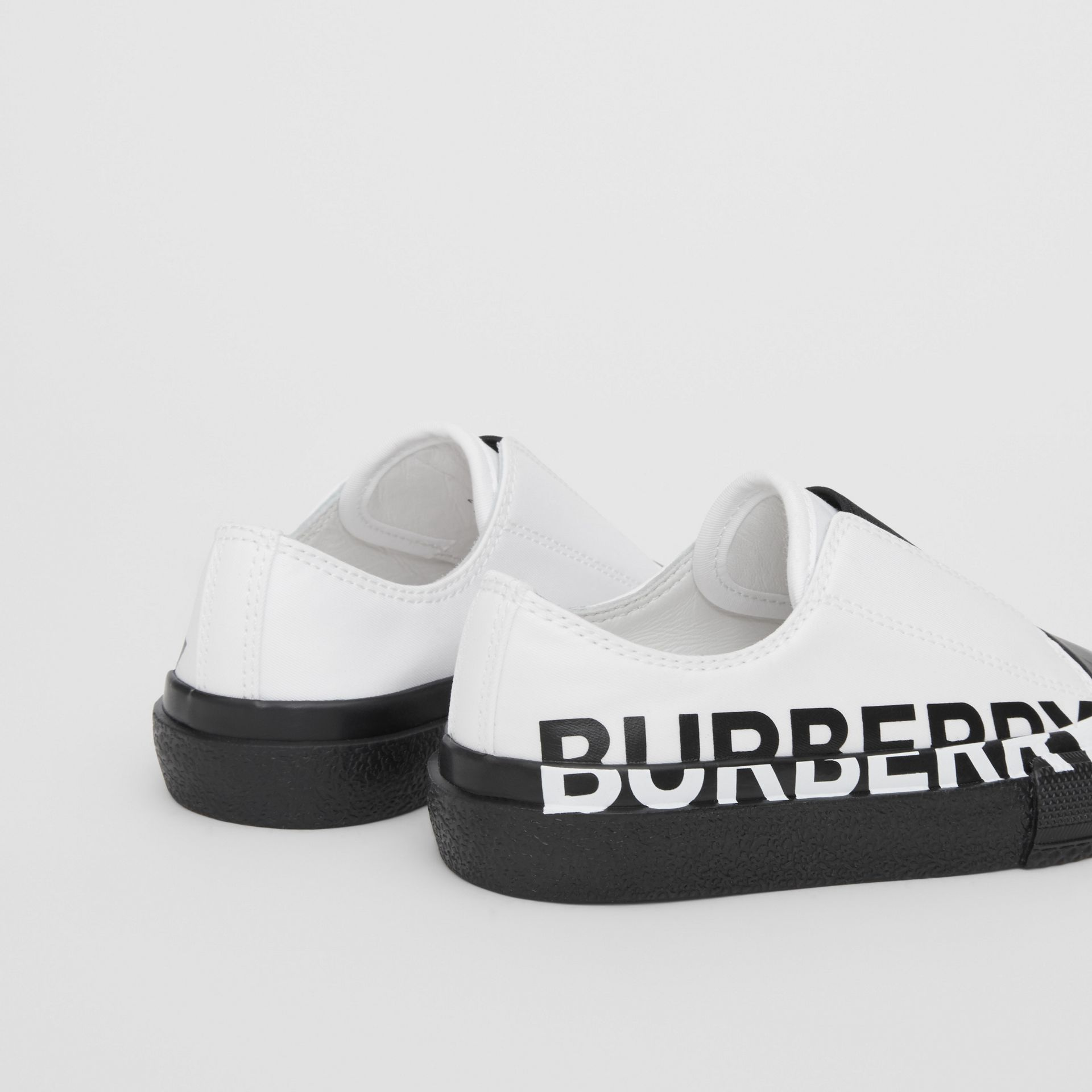 Logo Print Two-tone Cotton Gabardine Slip-on Sneakers in Optic White/black - Children | Burberry Singapore - gallery image 1