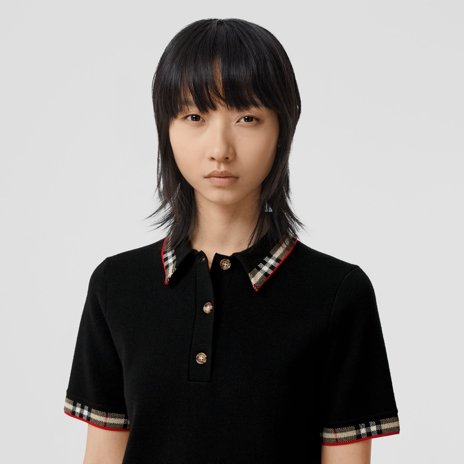 Check Trim Merino Wool Blend Polo Shirt in Black - Women | Burberry - gallery image 1