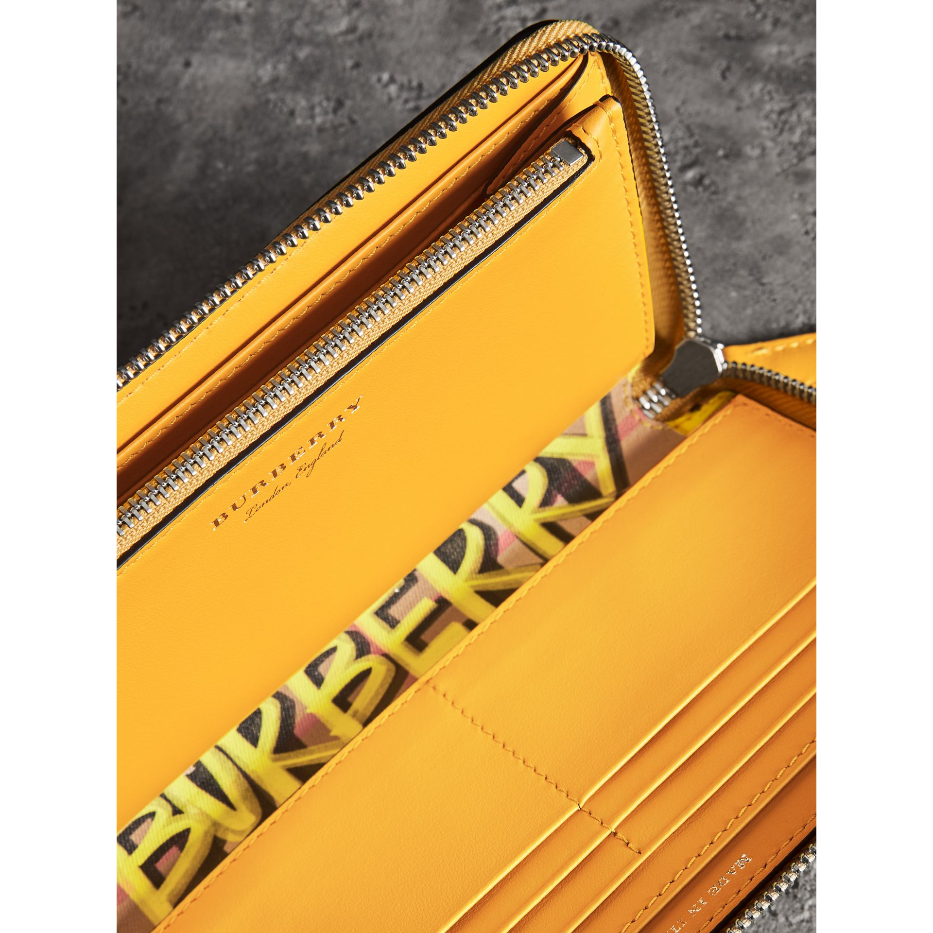 Graffiti Print Vintage Check Leather Ziparound Wallet in Yellow - Women | Burberry - gallery image 3