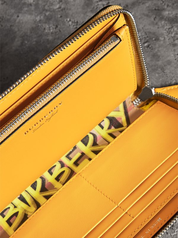 Graffiti Print Vintage Check Leather Ziparound Wallet in Yellow - Women | Burberry - cell image 3