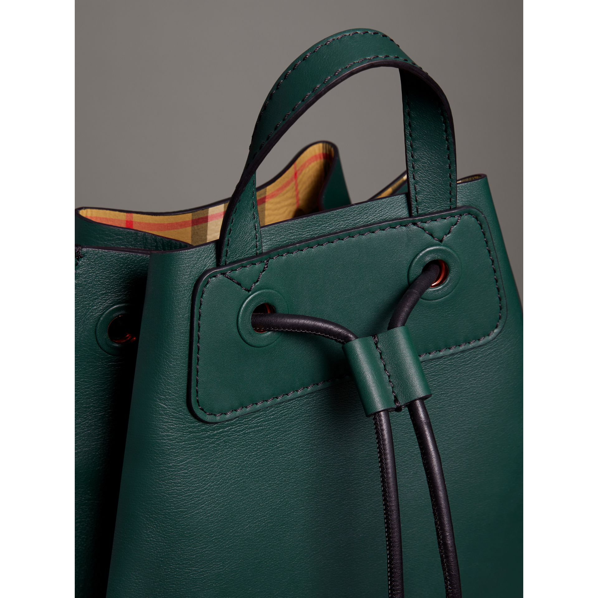 Graffiti Print Bonded Leather Drawcord Backpack in Deep Bottle Green - Men | Burberry Australia - gallery image 1