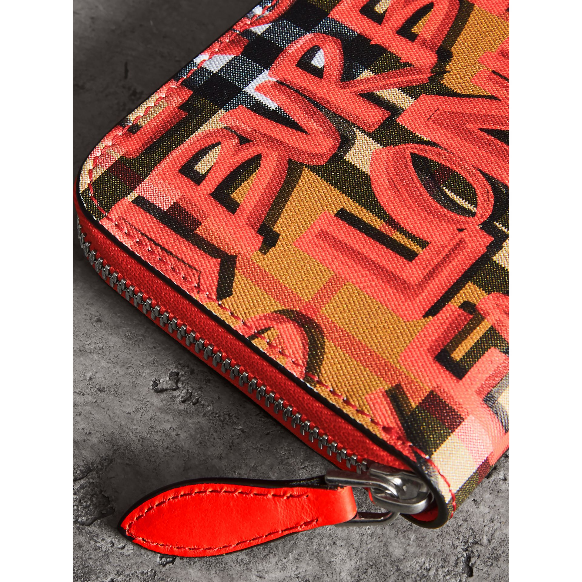 Graffiti Print Vintage Check Leather Ziparound Wallet in Red - Women | Burberry - gallery image 1