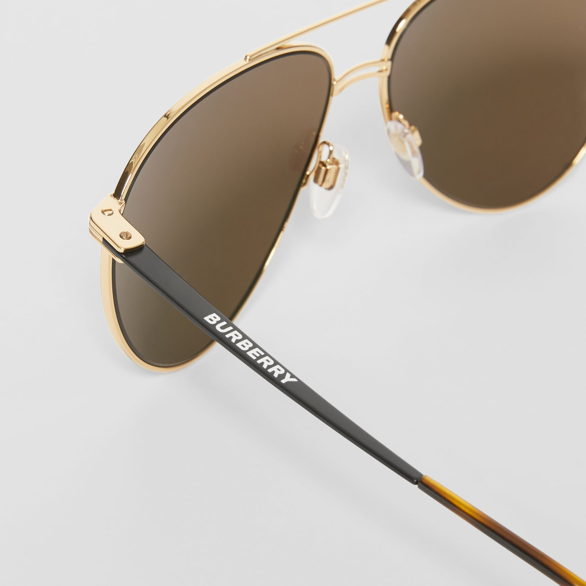 Top Bar Detail Pilot Sunglasses in Gold - Men | Burberry - gallery image 1